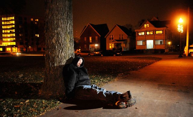 A homeless Donni Maass of Altoona rested in Wilson Park. Photo credit: Dan Reiland from Leader-Telegram.